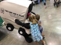 Truckie hugging kids at Family Fun Fest.jpg